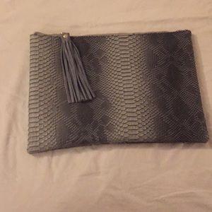 Faux snakeskin clutch with tassel zip